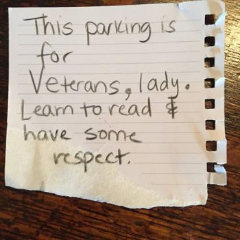 "Image of a note reading ""This is for Veterans, lady. Learn to read & have some respect."