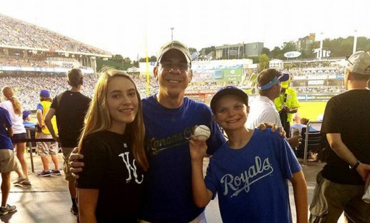 Image of an author and two children who gave him a baseball.