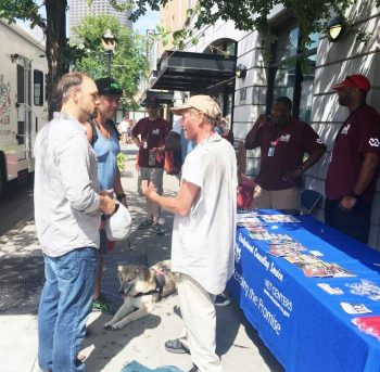 VA Mobile Vet Center team members speak with community members in downtown Dallas.