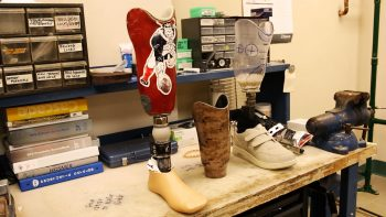 Image of two prosthetic feet at a Prosthetics Lab