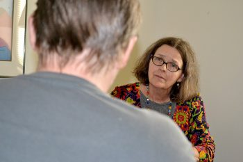 image of Dr. Sharon Baker talks to a Veteran participating in the program.