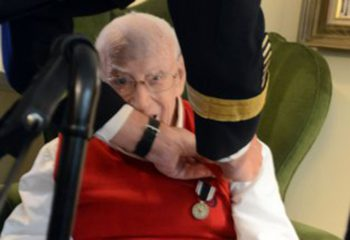 Dr. Charlie Stenger, a World War II Army veteran, is awarded the Prisoner of War Medal by Lt. Gen. James C. McConville, Army G-1, Aug. 16, 2016, at Stenger's home in Rockville, Maryland. (Photo Credit: David Vergun)