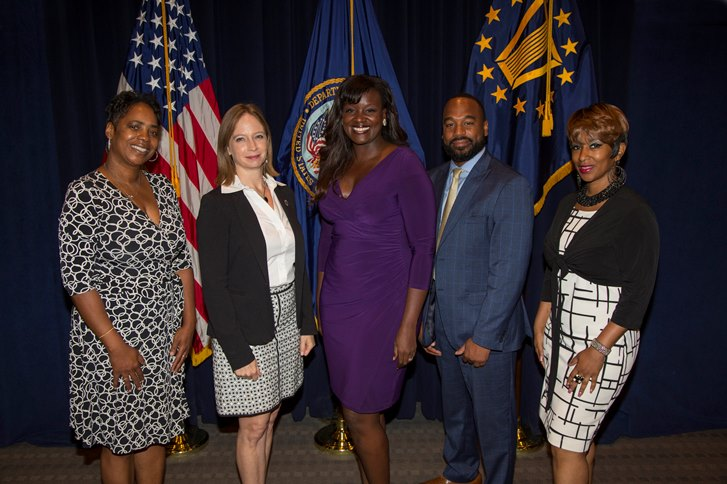 Image of Kayla Williams and four other celebrating Women's Equality Day at VA's central Office.