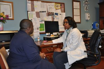 Gwen Adams-McAlpine, nurse practitioner at the Jackson VA in Mississippi, discusses a Hepatitis C treatment plan with a patient.