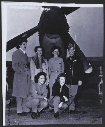 "Catherine V. Bridge nee Vail (back row, 2nd from right) and students from the Air Transport Command pose with a P-51 ""Mustang"" during Ferrying Transition Training, January, 1945. Catherine V. Bridge Collection, AFC/2001/001/34158."