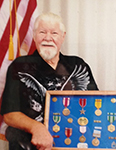 Image of Sgt. 1St Class Kenneth James Cline with his shaddow box.