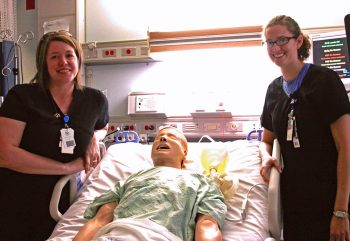 VA nurses Heather Frank (L) and Jill Jefferson along with Simulator SAM during ICU simulation training at the VA medical center in Des Moines, Iowa.