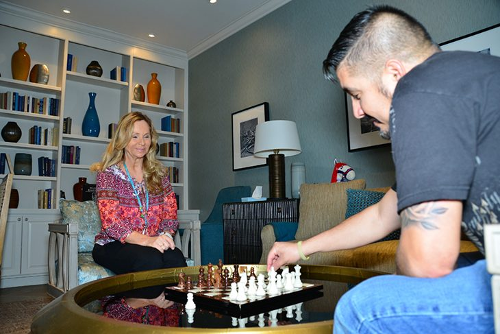 image of a man and woman playing chess