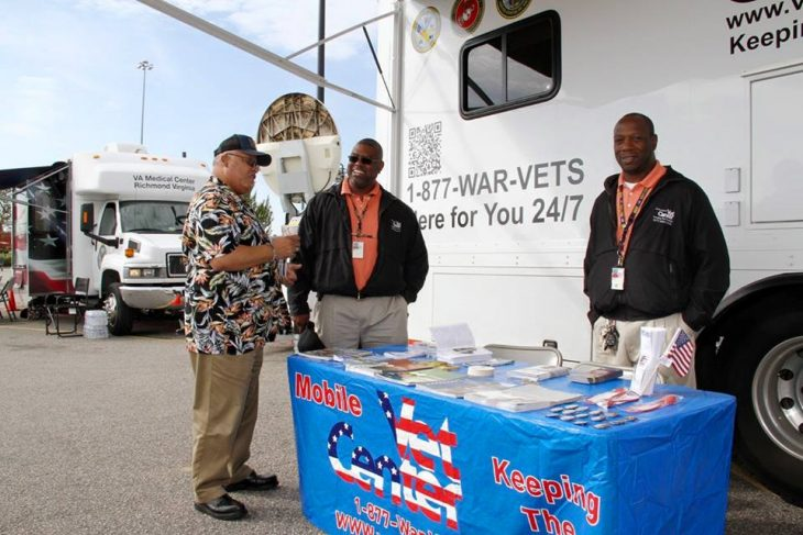 "Displaced Veteran Harold Hammond of nearby Maxton who described his home as ""an island"" talks to Greensboro Mobile Vet Center counselor Ron Thomas, center, MVC technician Marcus Pickett"