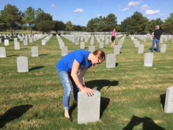 Volunteers clean headstones at VA national cemeteries