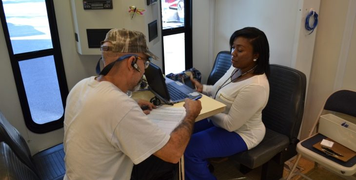 Advanced Medical Support Assistant and Army Veteran Sherry Montgomery talks to a Veteran while he checks in for an appointment about his health care. He stopped by the VA/MMU in Tarboro, N.C. for treatment when the unit was set up there to offer area Veterans health care in the aftermath of hurricane Matthew.