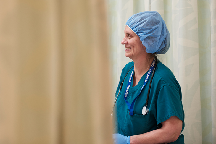 VA Nurse shares in warm conversation with a patient