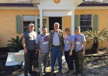 Amy Blowers, her team and the homeowner, whose experience is mentioned at the end of the article.