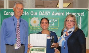 Martha Peak-Sweet, RN, is presented with her DAISY Award by Pam Crowell, Associate Director, and John Goldizen, Associate Deputy of Nursing and Patient Care Services.