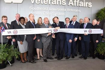 Officials gather to cut the symbolic ribbon at the New Orleans VA Hospital, celebrating the grand opening