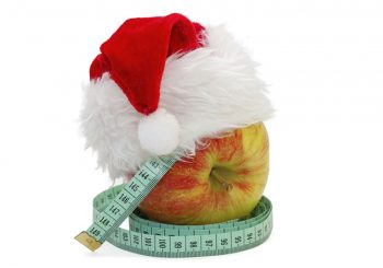 image of an Apple with a measuring meter, in a cap Santa Claus