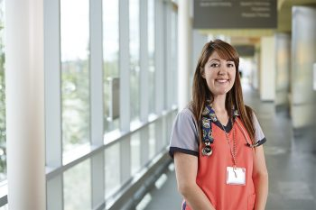 A VA volunteer flashes a smile during her volunteering shift.