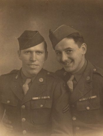 brown and white picture of Joe Farinholt (left), taken while serving in England during Word War II, spring 1944.
