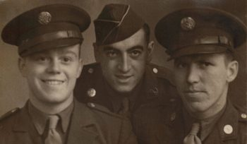 picture of Joe Farinholt (right) posing with fellow platoon members Bill Stamos (center) and Stephen McNeil (left). While under Farinholt's command at Bourheim, Germany, Stamos was one of four others in the platoon to earn Silver Stars. Stamos received it for actions performed on November 23, 1944.