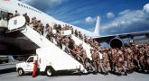 Marines boarding a commercial aircraft to support coalition forces for Operation Desert Shield.