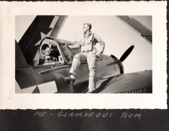 Image of : Thomas with a WII plane during the war.