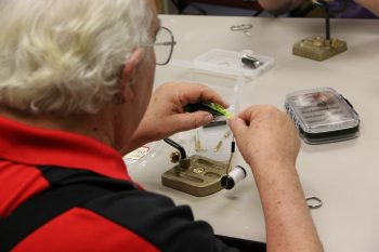 Veteran participating in recreational therapy fly tying