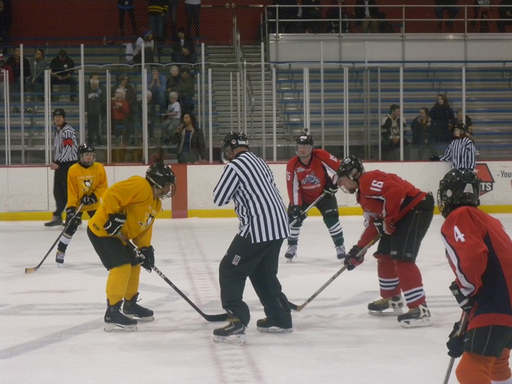 Image of blinded Veterans 'facing off' in a hocky match.