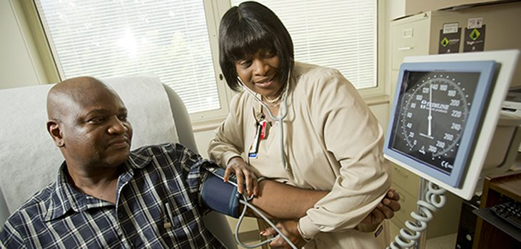 IMAGE: Nurse Charlene Baker checks Lawrence Woodson's blood pressure at the Philadelphia VA Medical Center.