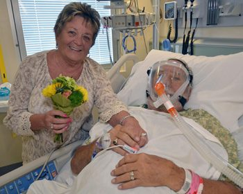 Jane and Homer Johnson hold hands at his bedside after their wedding ceremony at the James A. Haley Veterans' Hospital Medical Intensive Care Unit March 2.