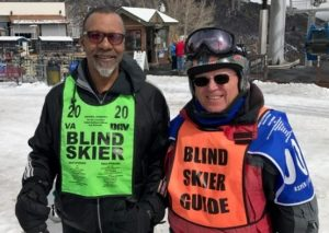 Image Air Force Veteran Miguel Davis-Dacio takes a moment after downhill skiing to chat new strategies with his Ski Instructor Randy Benson of Los Angeles after his first trip down the mountain.