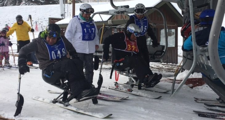 image of Veterans using a chairlift to the top of the mounain.