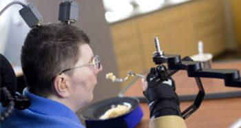 Image: Bill Kochevar, a Navy Veteran and spinal cord injury patient, participates in BrainGate2 research, using the implanted technology to move his arm.