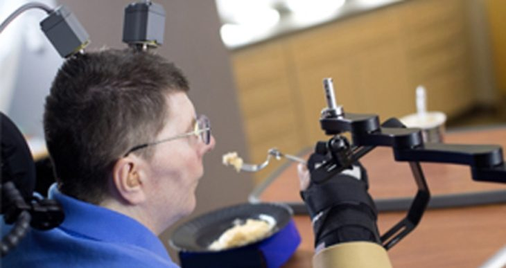 Paralyzed Navy Veteran regains use of arm with implanted system