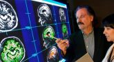 Image of VA researchers looking at brain scans