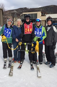 Image of Stephen with his parents and skiing assistants.