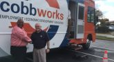 image of Jim Montgomery (right), Mobile Career Center Coordinator and Dedric Townsend (left) with National Properties Solutions Group (NPSG).