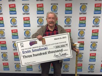 Ervin Smolinski smiles after collecting his $300,000 prize.