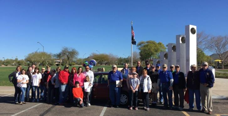 Prescott Veteran and Prescott VA National Cemetery Employee Ryan Ockomon receives car from Daisy Mountain Veterans.