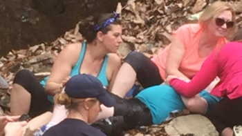 IMage of Renee Belliveau (left) and Tammy Belliveau (right) care for the injured youth.