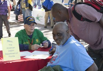 Dave Miller assists homeless Veterans and those at risk during a Stand Down for Homeless Veterans event at the C.W. Bill Young VA Medical Center