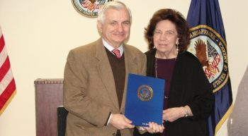 Image of Carla Murchelano being presented a certificate of appreciation