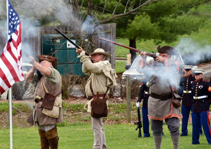 Members of the Sons of the American Revolution present a rifle salute at an event dedicating a new Gold Star Families memorial in Lexington, Kentucky.