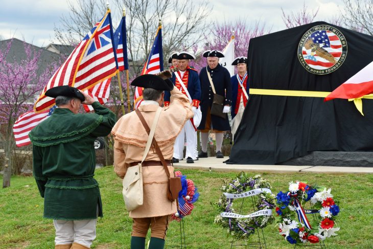 Members of the Sons of the American Revolution render honors after presenting a wreath at an event dedicating a new Gold Star Families memorial in Lexington, Kentucky.