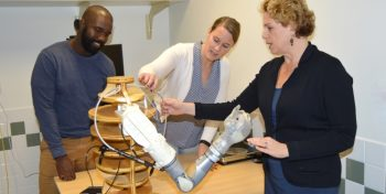 IMAGE: Dr Resnick (far right) discusses specific aspects of the t Life Under Kinetic Evolution Arm for Veterans with upper-limb amputation with VA Research Health Science Specialist Frantzy Acluche, and Project Coordinator Sarah Ekerholm.
