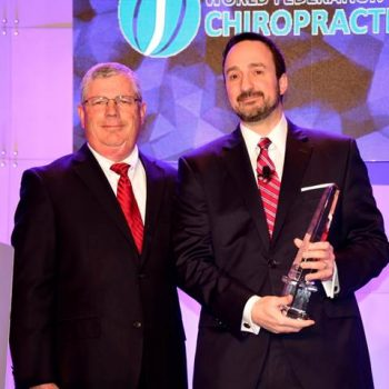 Image of Dr. Lesi recieving the award