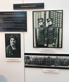 Historical images of female Marines hanging on a wall.