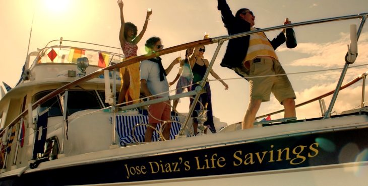 """Image of people partying on a boat with the name """"Jose Diaz's life savings' on the bow."""