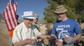 Image: Retired U.S. Army Col. Ben Skardon, 99, a survivor of the Bataan Death March, shares a laugh with Master Sgt. Mike Lavigne, a volunteer at water station one of the Bataan Memorial Death March, at White Sands Missile Range, N.M., March 18, 2017. Skardon is the only Bataan survivor who walks in the memorial march. He walks eight and a half miles and this was the tenth time he did it. (U.S. Army Reserve photo by Staff Sgt. Ken Scar)