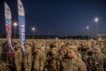 Image: More than 7,200 participants in the 28th annual Bataan Memorial Death March salute as the National Anthem plays during opening ceremonies at White Sands Missile Range, N.M., March 19, 2017. (U.S. Army Reserve photo by Staff Sgt. Ken Scar)