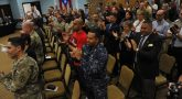 Audience members applaud during a Warrior Training Advancement Course graduation ceremony Mar. 30. The department of Veterans Affairs and Defense Department partnership training course prepares transitioning service members to join VA as Veteran service representatives. (U.S. Army photo by Spec. Anthony Martinez)
